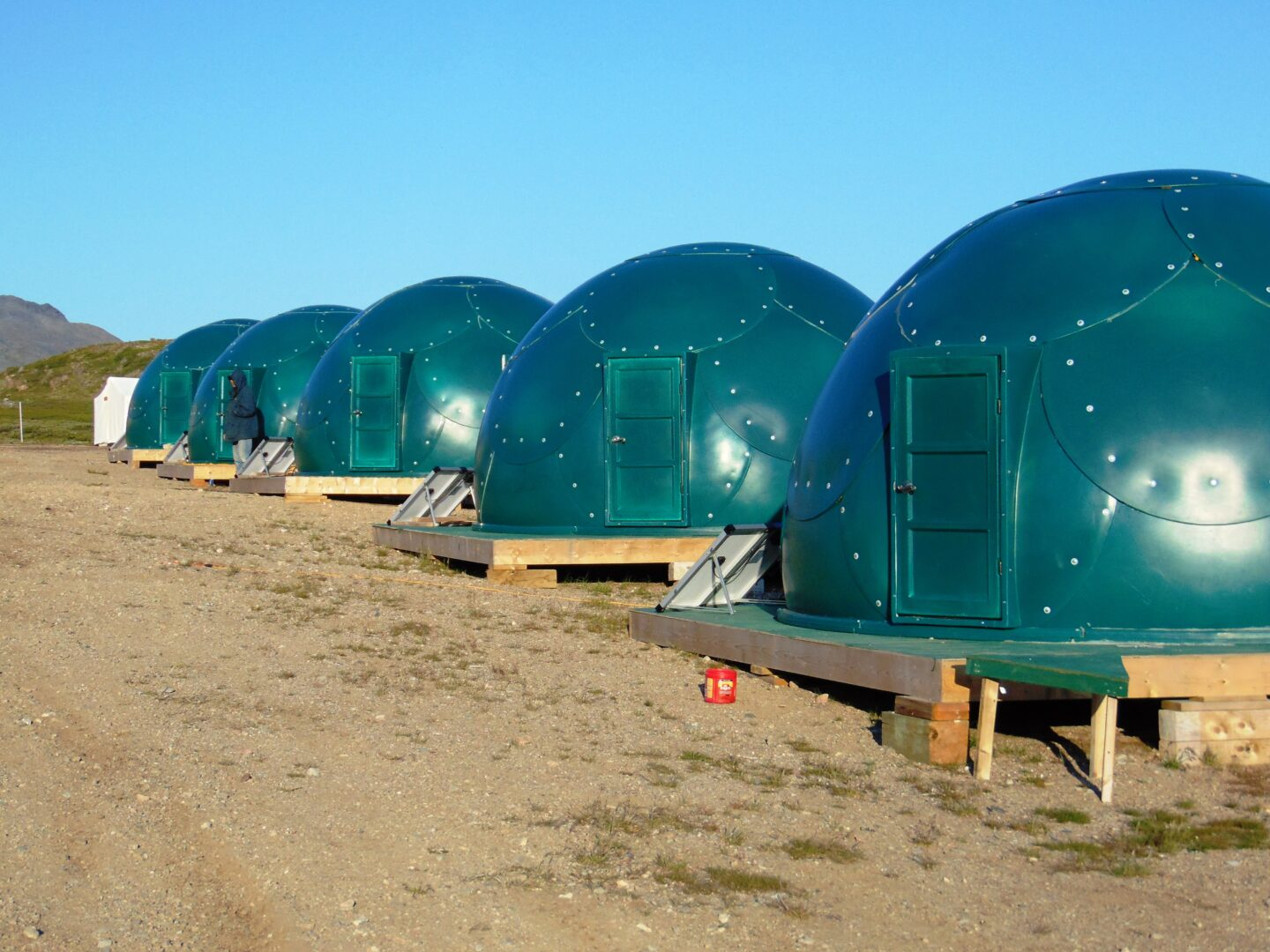 green military-grade safety shelters from InterShelter Inc.