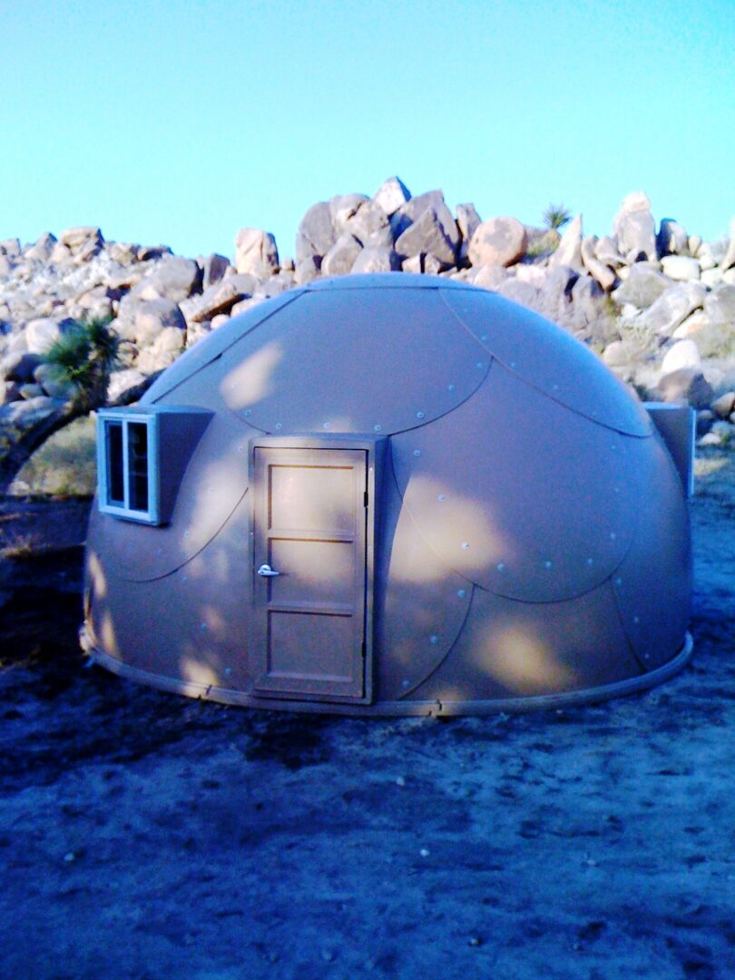 brown military-grade safety shelter with windows from InterShelter Inc.