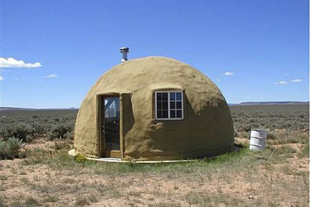 Mud-covered, military-grade safety shelter from InterShelter Inc