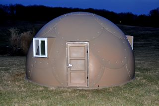 brown military-grade safety shelter from InterShelter Inc.