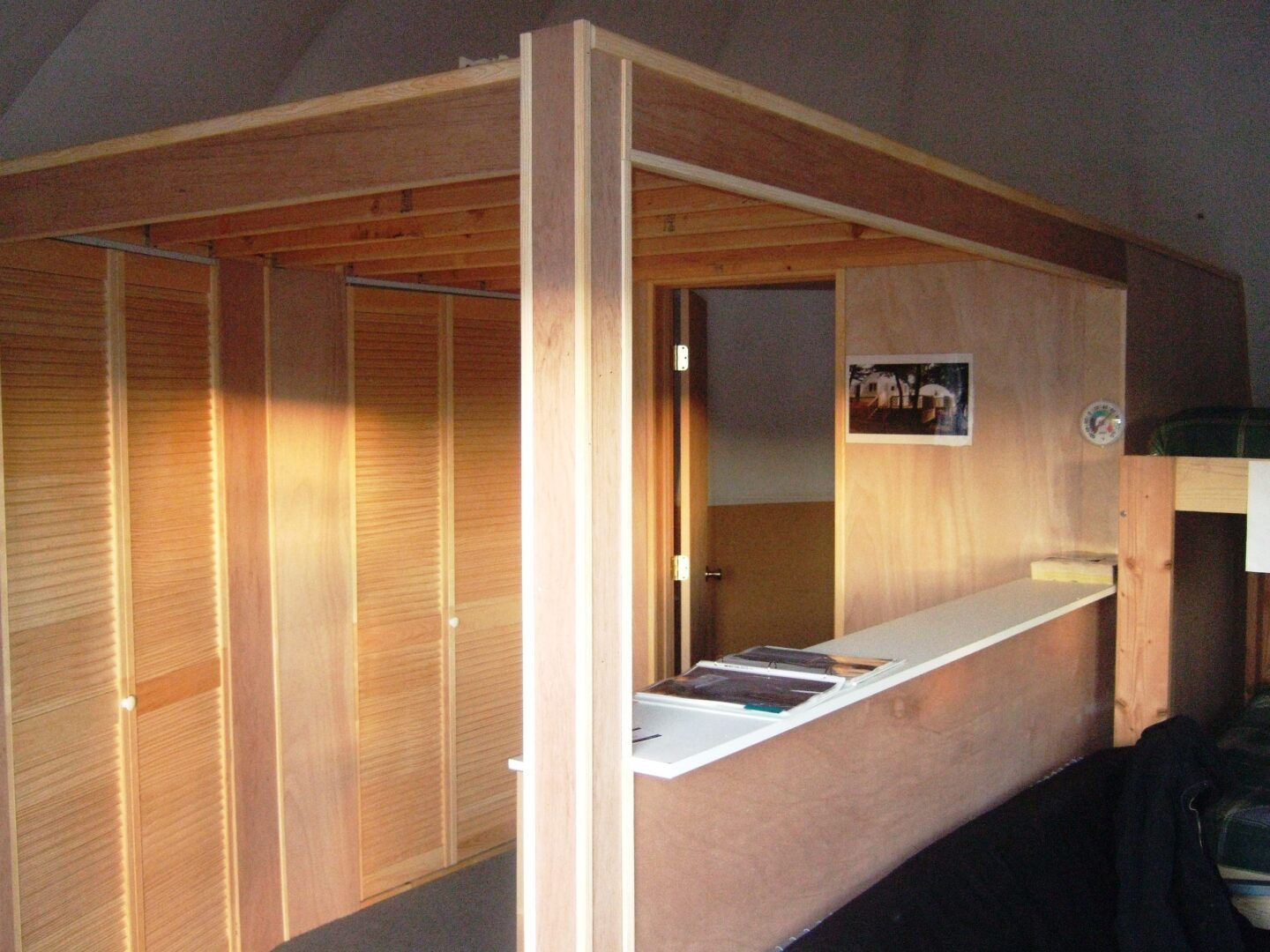 Tiny house with wooden rooms and partitions from InterShelter Inc.