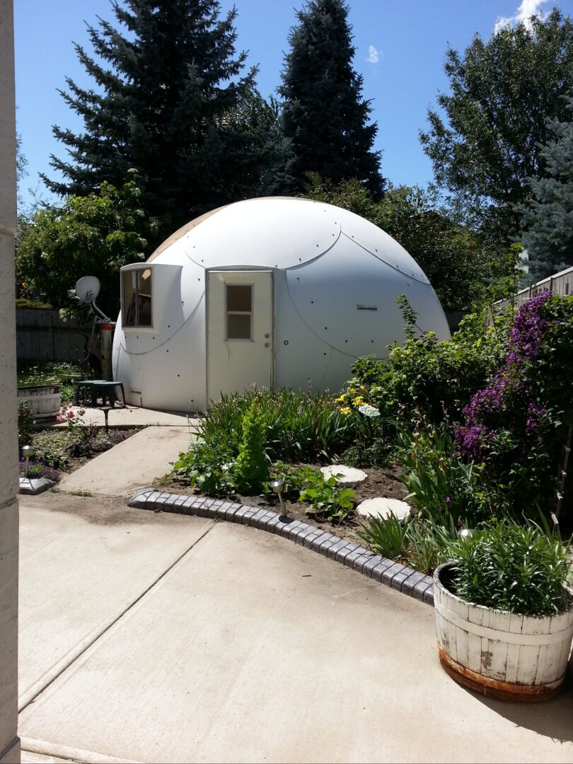 Tiny house from InterShelter Inc. with surrounding garden