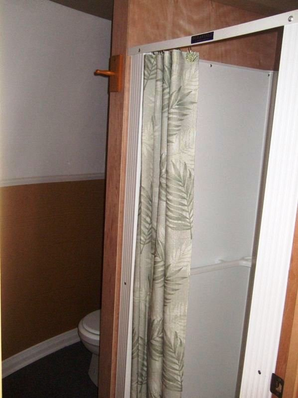small shower space inside tiny house or safety shelter from InterShelter Inc.