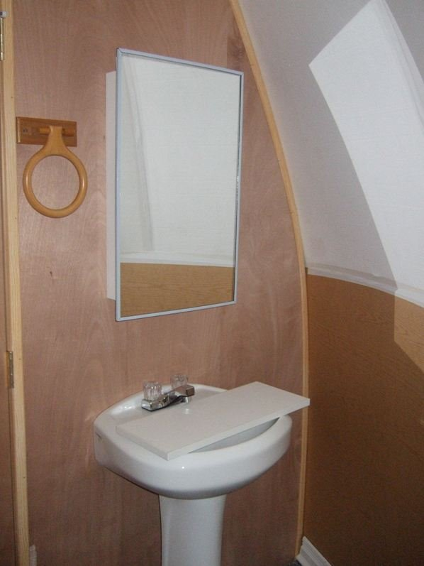 small washroom inside tiny house or safety shelter from InterShelter Inc.