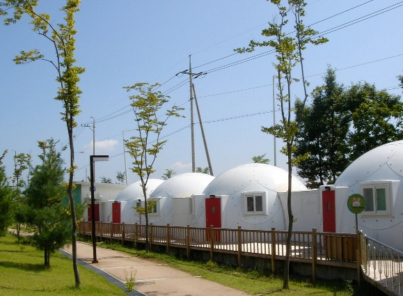 Tiny houses or safety shelters with red doors from InterShelter Inc.